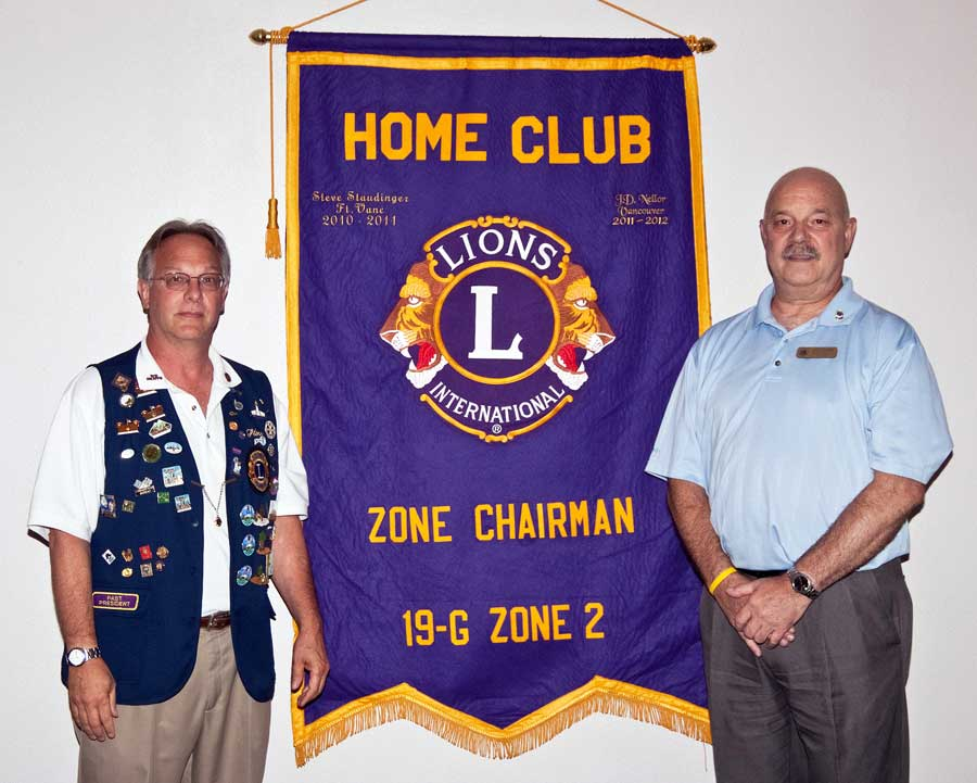 picture of J D Nellor receiving zone chair banner